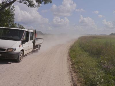 Rural road untreated with dust-free and ecofriendly products